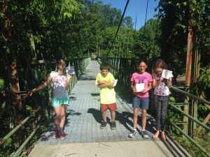 Students trying out the quest, a bit nervous as they prepare to cross the Swing Bridge!